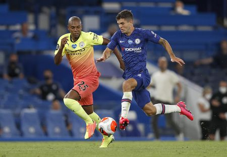 Christian Pulisic races past Fernandinho